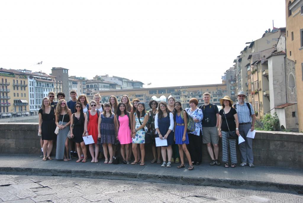 Admiring beautiful view of the Arno River and the Ponte Vecchio from the Ponte Santa Trinita.